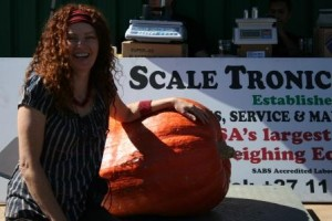 "A very happy Jane Griffiths and ""THE"" guestimate pumpkin."